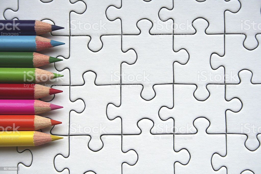 Pencils on jigsaw pattern royalty-free stock photo