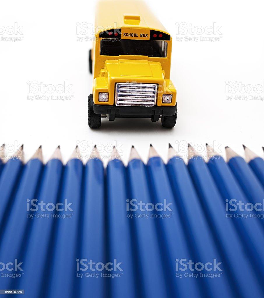 Pencils Versus School Bus royalty-free stock photo