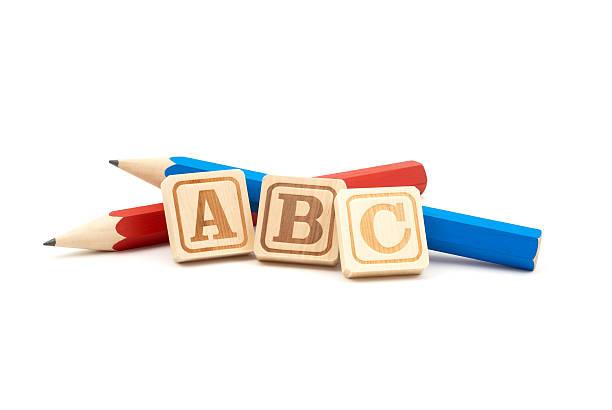 鉛筆、木製のアルファベットブロック ストックフォト