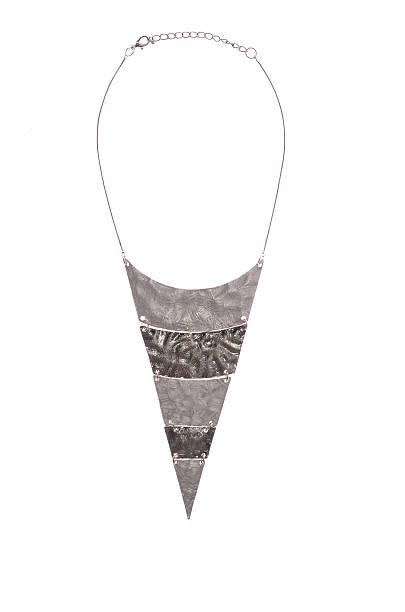 pendant of iron plates on a white background - juwel trigon stock-fotos und bilder