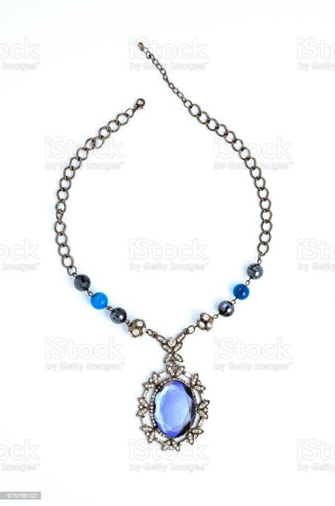 pendant with precious stones on a white background stock photo