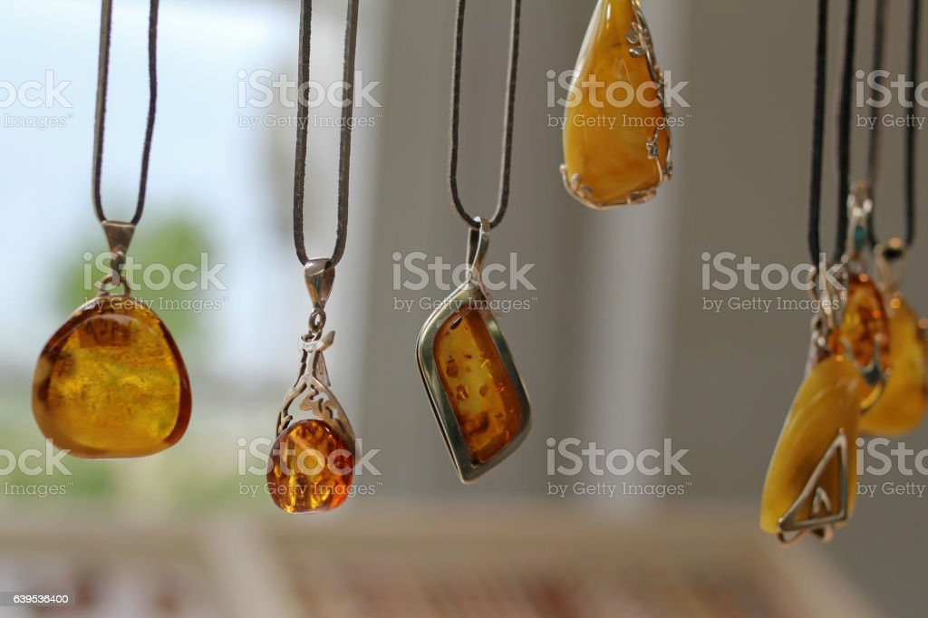 Pendants with amber for sale - foto stock