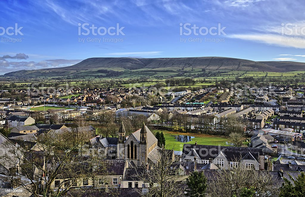 Pendle Hill, viewed across the town of Clitheroe stock photo
