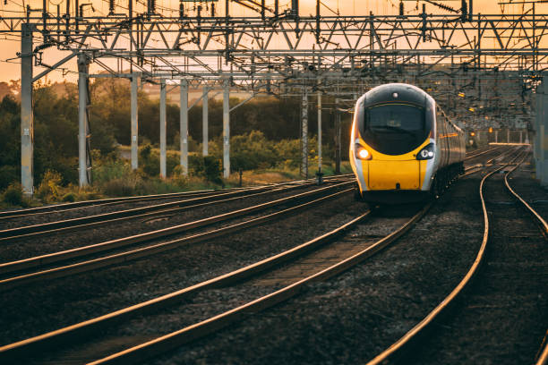 Pendolino at Sunset Pendolino passes as the sun set in the background bullet train stock pictures, royalty-free photos & images