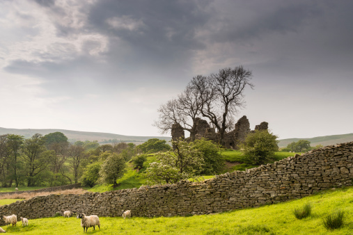 Pendragon Castle behind dry stone wall