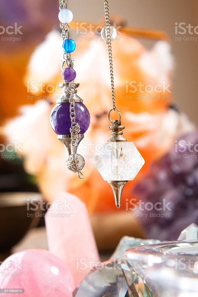 Pendulum and crystals stock photo