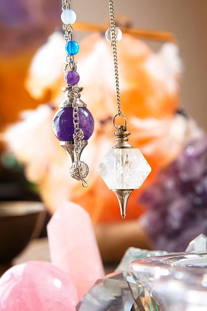 pendulum and crystals - pendulum stock photos and pictures