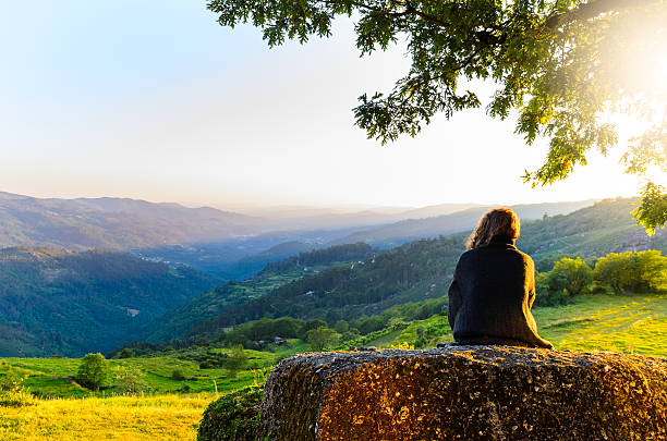 Peneda-Geres National Park scenic view of woman watching at sunset mountains, Peneda-Geres National Park, northern Portugal. tranquil scene stock pictures, royalty-free photos & images