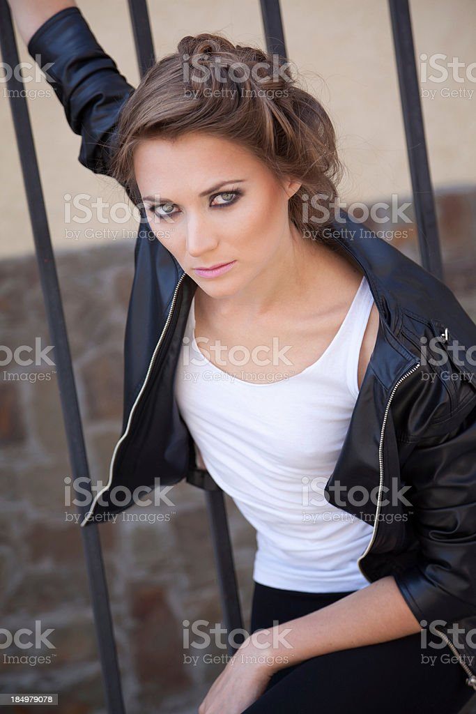Penetrating glance of young woman with sophisticated hairstyle royalty-free stock photo