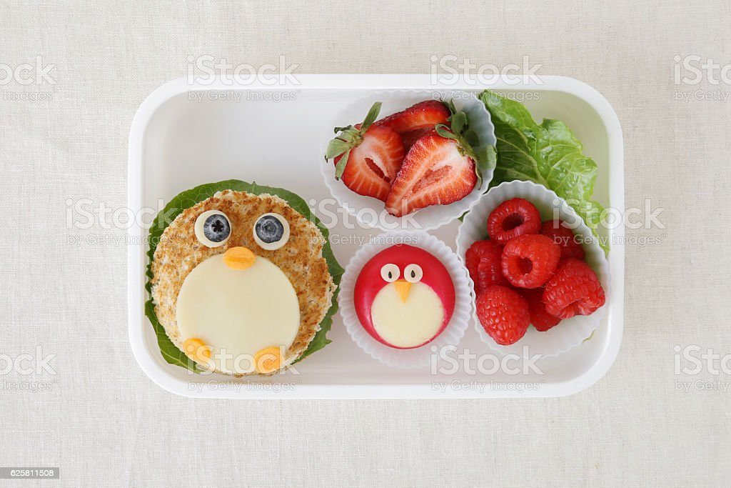 penguin healthy lunch box, fun food art for kids stock photo