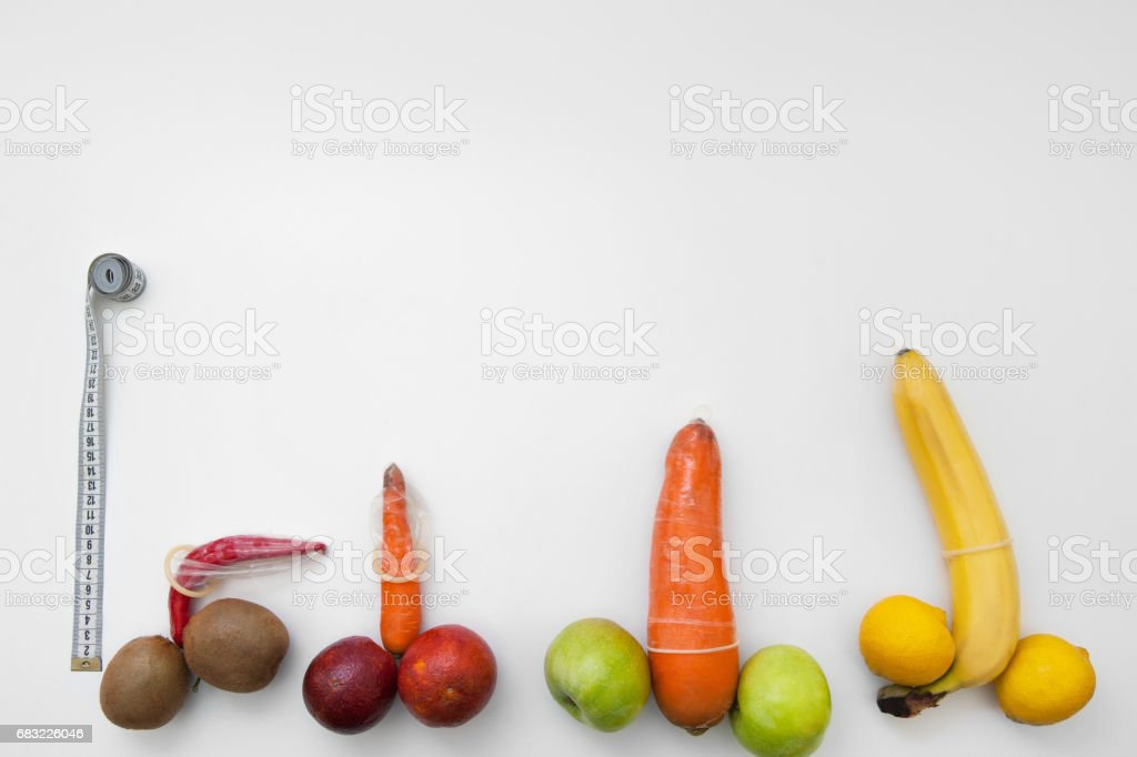 Penis measure. Phallus with erection in condoms stock photo