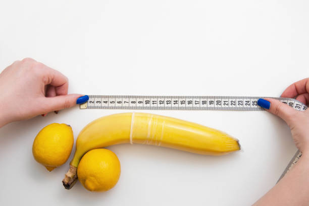 Penis size, measure tape, sex and satisfaction stock photo