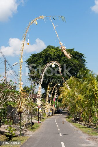 Penjors to celebrate the Galungal festival on a street in Bali, Indonesia