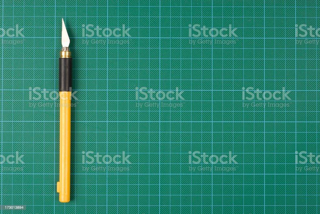 Penknife on Cutting Mat stock photo