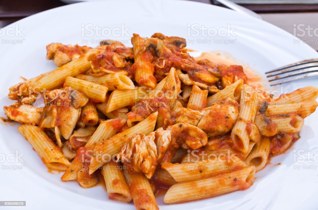 Penne - chicken and tomato sauce stock photo