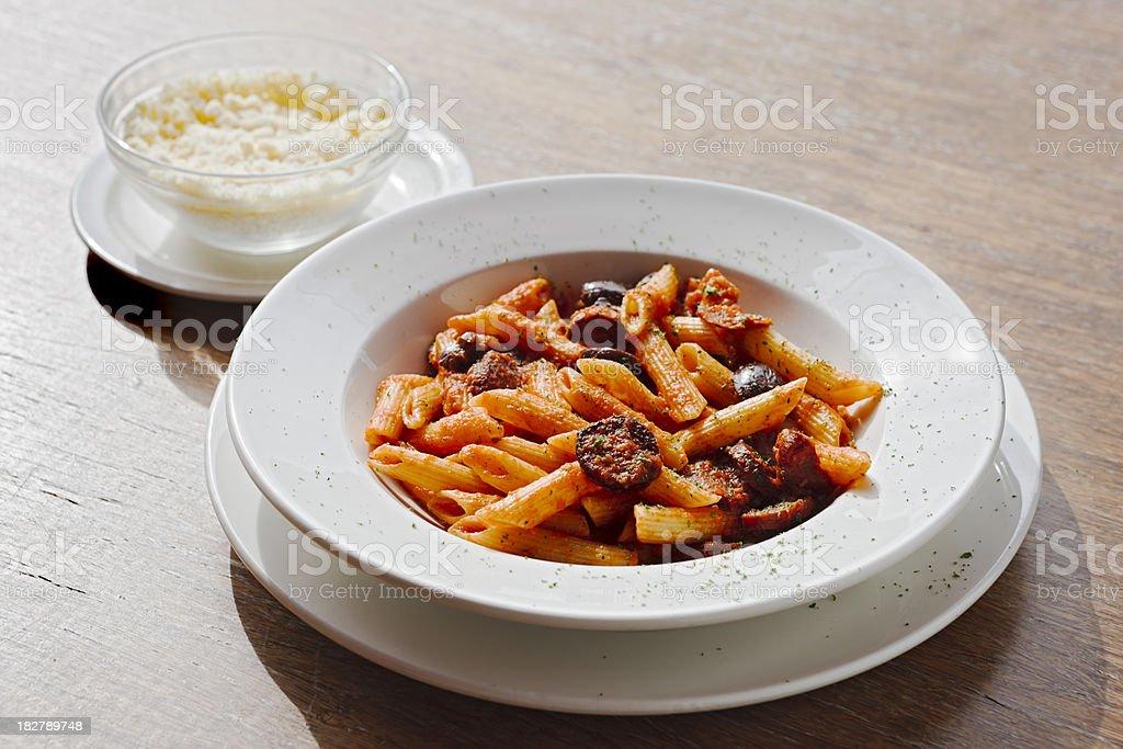 Penne pasta, chorizo, parmesan cheese - delicious! royalty-free stock photo