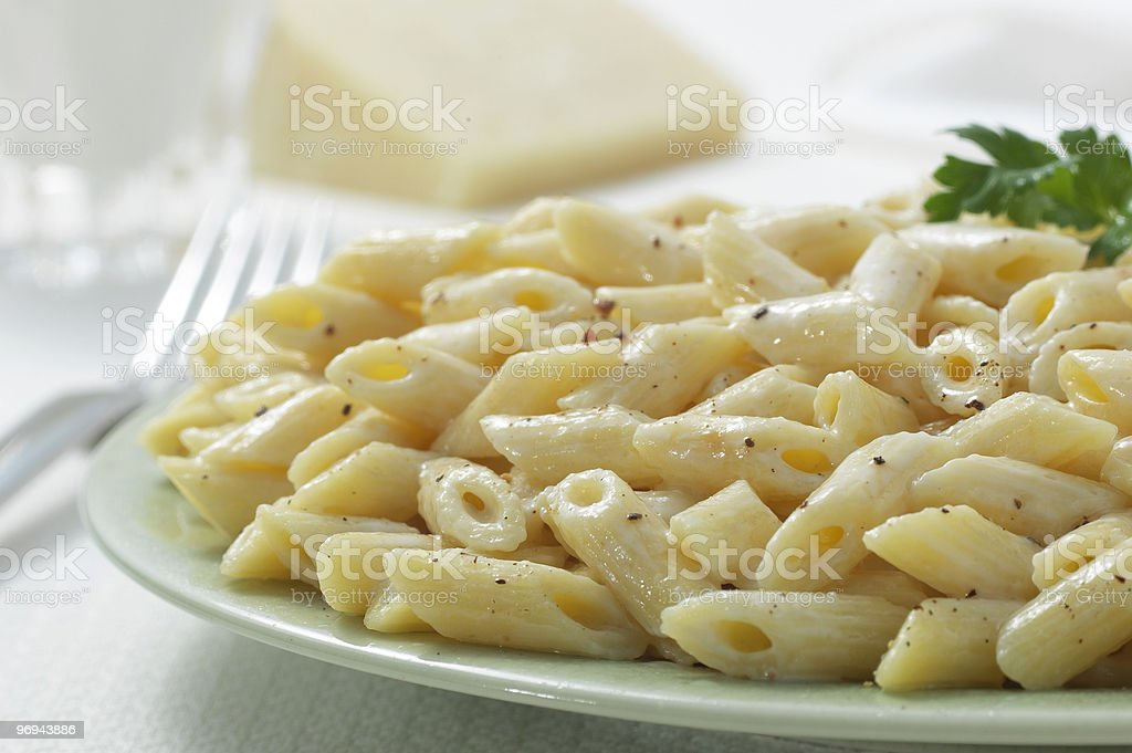 Penne pasta Closeup w/milk & cheese royalty-free stock photo