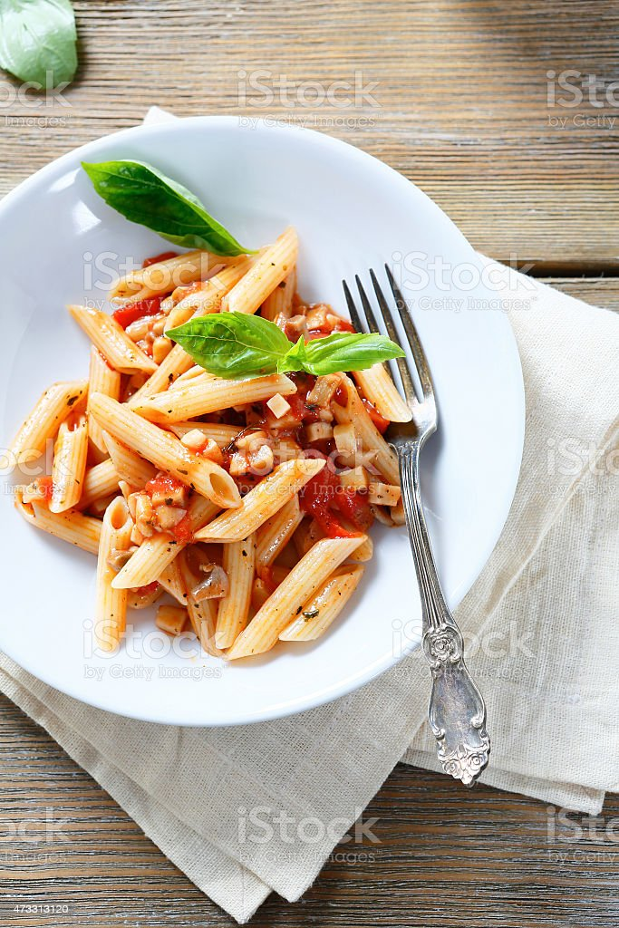 penne pasta in a bowl stock photo