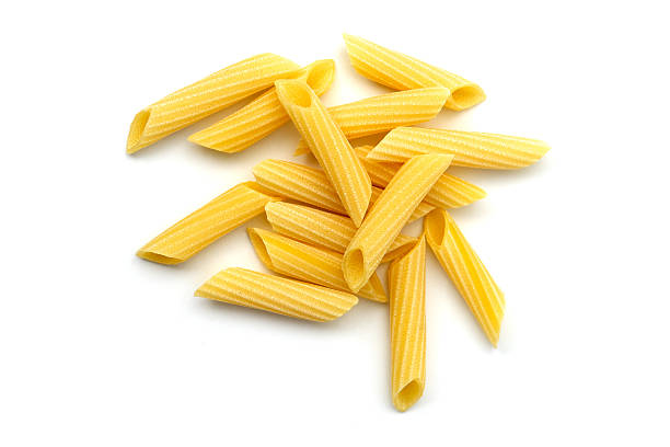 Pasta penne Penne pasta uncooked white background pasta photos stock pictures, royalty-free photos & images