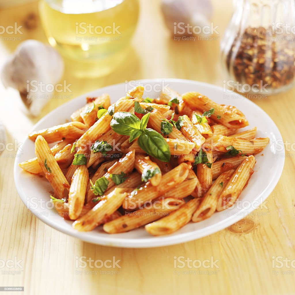 penne pasta smothered in tomato sauce stock photo