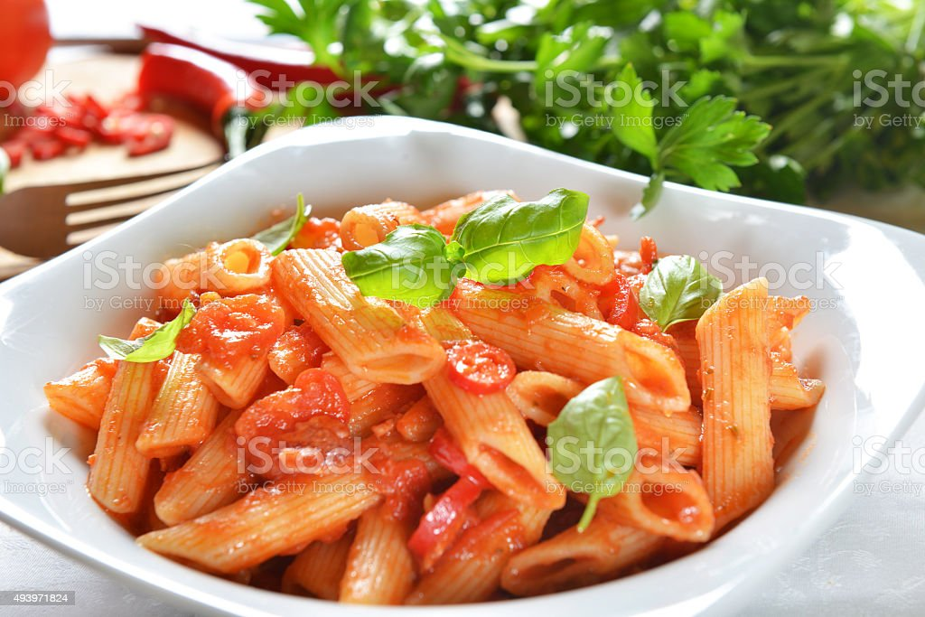 Penne pasta with chili sauce arrabiata stock photo