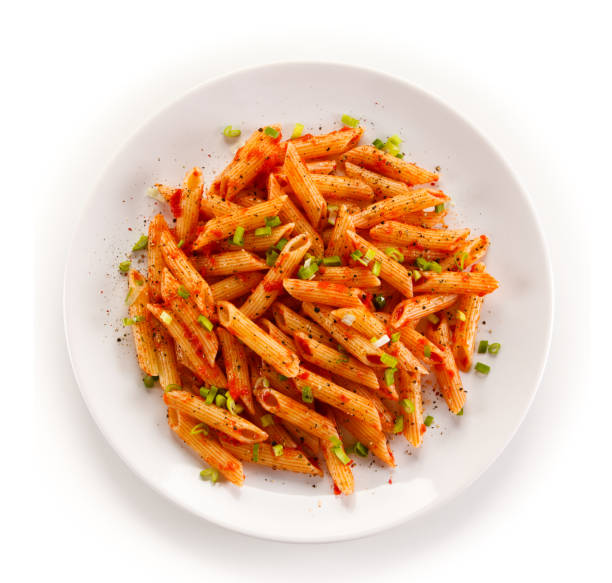 Penne, pesto sauce and vegetables Penne, pesto sauce and vegetables on white background penne stock pictures, royalty-free photos & images