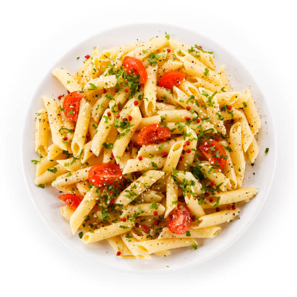 Penne, pesto sauce and vegetables stock photo