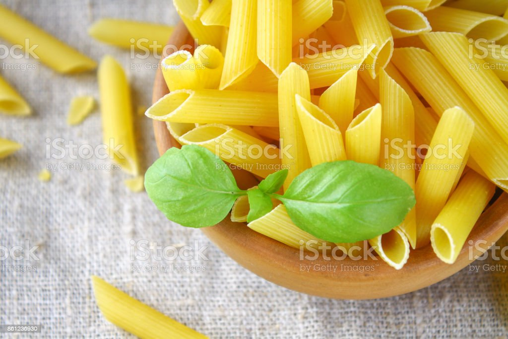 Penne rigate. Macaroni in the form of feathers. mostaccioli pasta stock photo