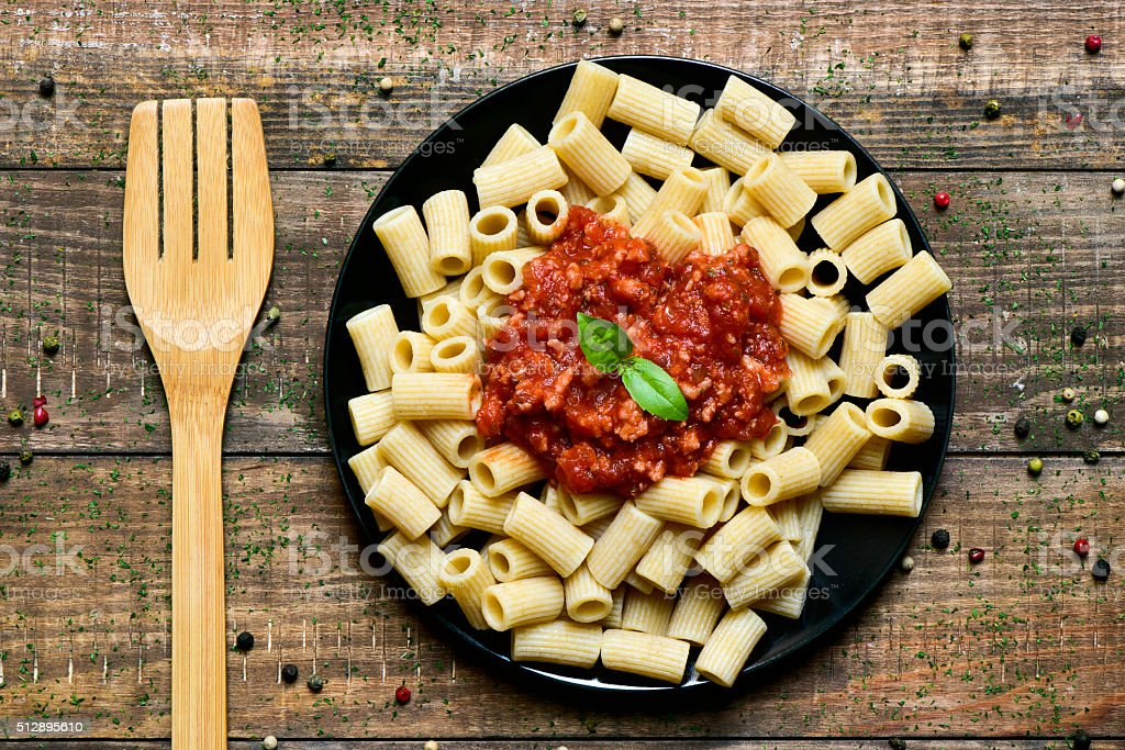 penne rigate with bolognese sauce stock photo