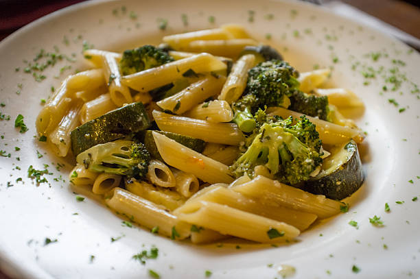 Penne White Wine Sauce Vegetarian penne primavera with white wine sauce and green vegetables primavera stock pictures, royalty-free photos & images