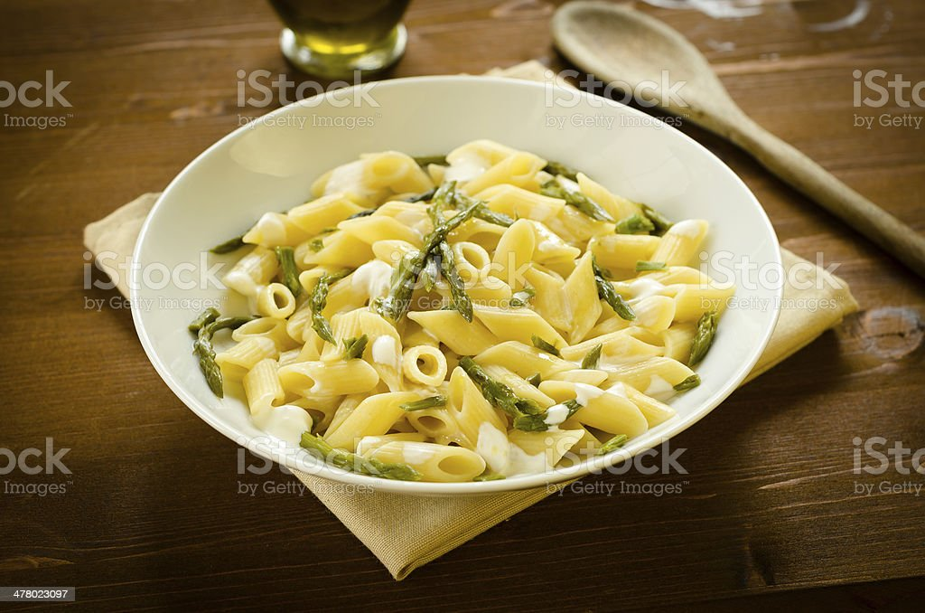 Penne with asparagus and cream stock photo
