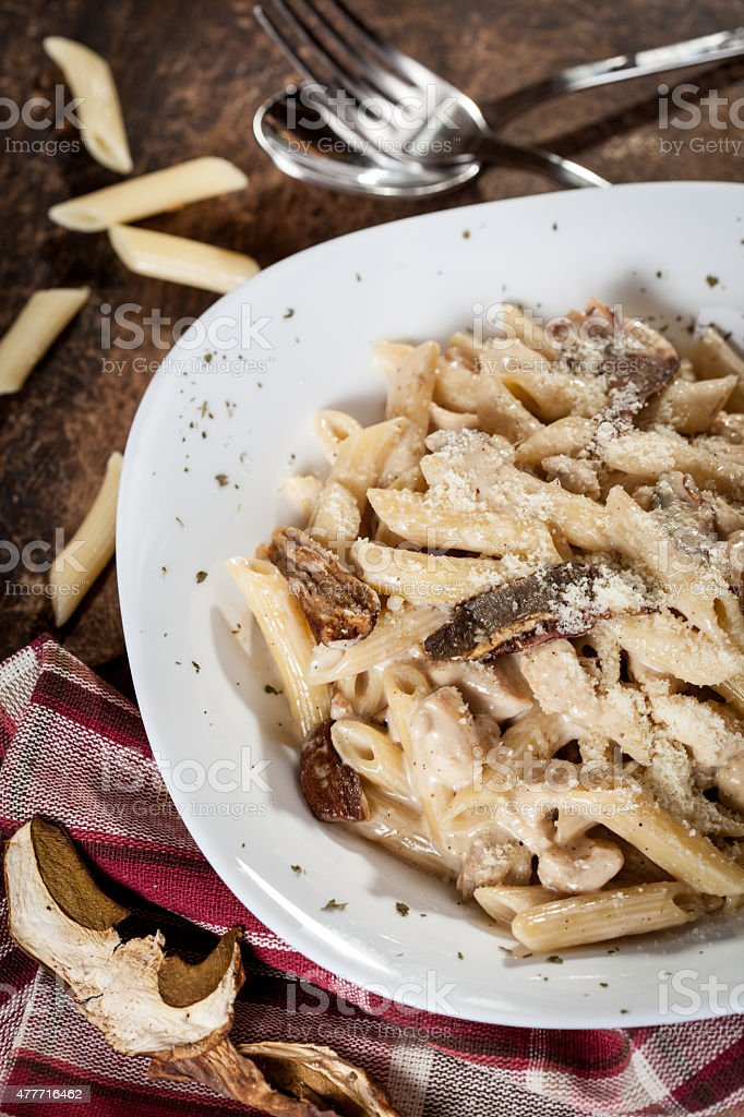 Penne with boletus and bacon sauce stock photo