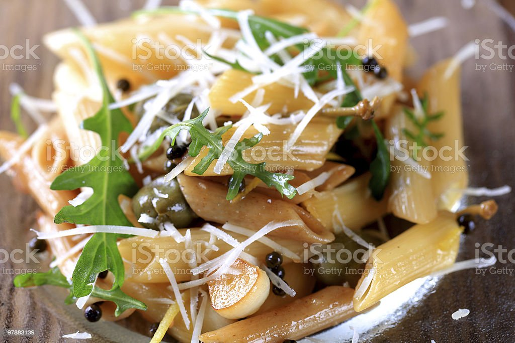 Penne with pickled peppercorns and capers royalty-free stock photo