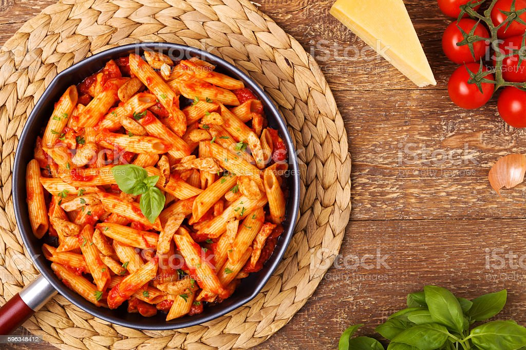 Penne with roasted chicken in tomato sauce royalty-free stock photo