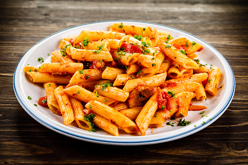 Penne with sauce and pork