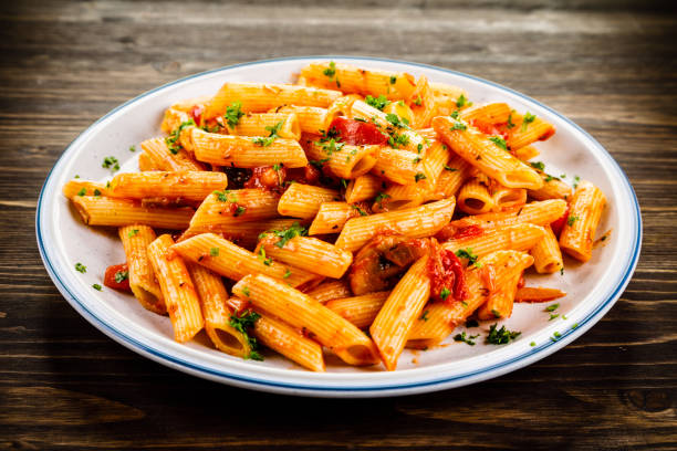 Penne with sauce and pork Pasta with vegetables fusilli stock pictures, royalty-free photos & images