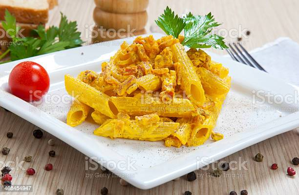 Penne With Speck And Saffron Stock Photo - Download Image Now