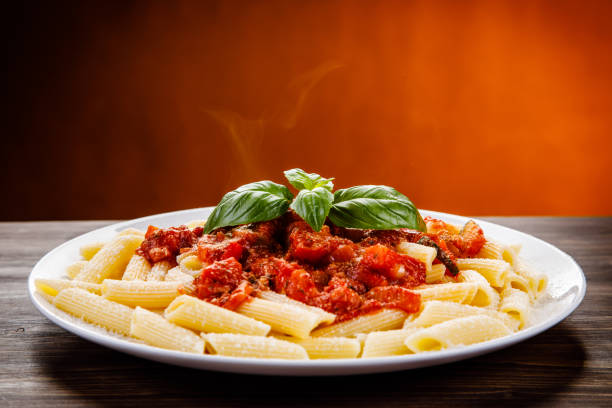 Penne with tomato sauce and pork Penne with tomato sauce and pork macaroni stock pictures, royalty-free photos & images