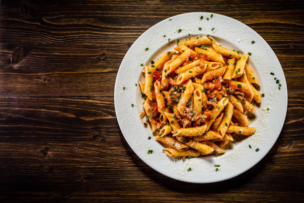Penne with tomato sauce and pork Penne with tomato sauce and pork bolognese sauce stock pictures, royalty-free photos & images