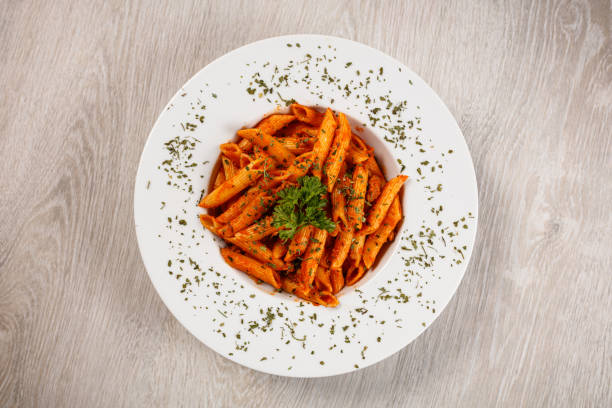 Penne with tomato sauce and pork Penne pasta in tomato sauce with meat, tomatoes penne stock pictures, royalty-free photos & images