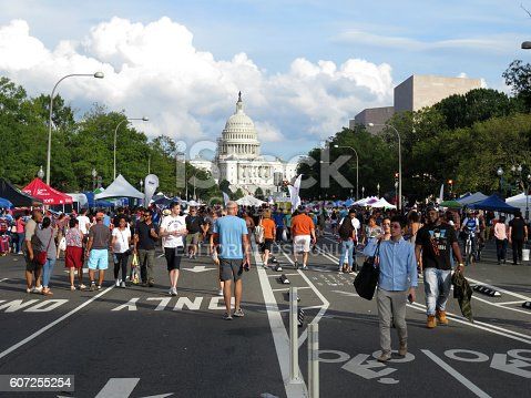Washington DC, USA-September 18, 2016:  These people are spotted walking on Pennsylvania Avenue at the Fiesta DC Latino Festival in Washington DC.  They are walking to find free music entertainment, free food and other giveaways.  Fiesta DC is a two day event with a parade on Saturday and a street festival on Sunday.  This is the street festival on Sunday featuring food, music and free giveaways.  The festival is free.