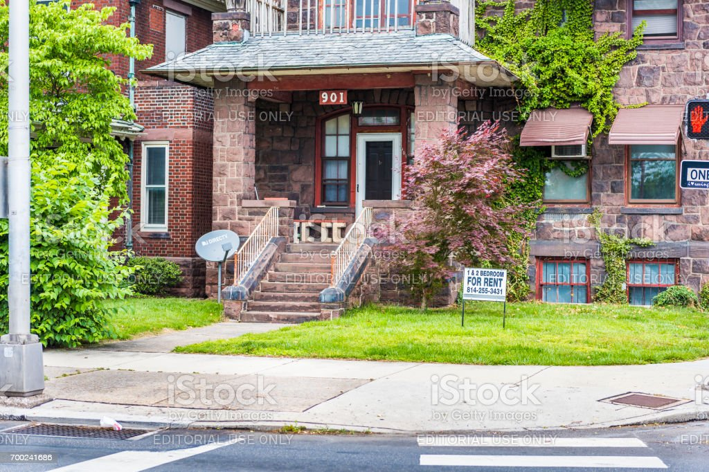 Pennsylvania capital city house with for rent sign in downtown by sidewalk street stock photo