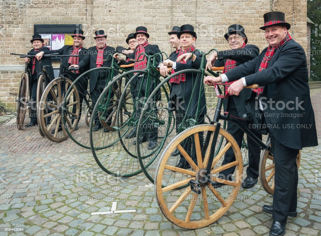 Penny farthing riders during the Dickens Festival in Deventer stock photo