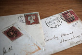 Old, cancelled stamps shown with Magnifying Glass & Tweezers used for the hobby of stamp collecting - a lot of great color and detail.     http://i658.photobucket.com/albums/uu308/davidjames08/PostCards_Stamps-GreenTop.jpg