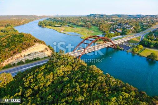501329818istockphoto Pennybacker 360 bridge, Colorado River, Austin Texas, aerial panorama 168413330