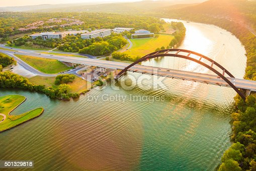 Panoramic aerial view from helicopter of 360 bridge on Colorado River near Austin Texas, looking west at sunset.