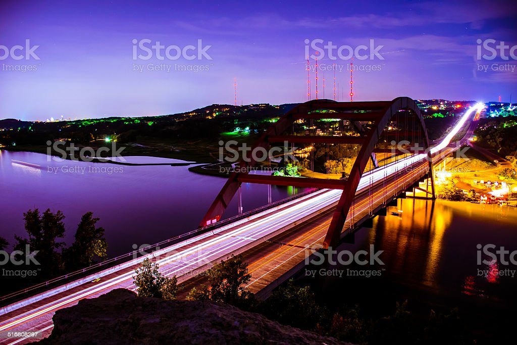 Pennybacker / 360 bridge with cars and lights and bright colors stock photo