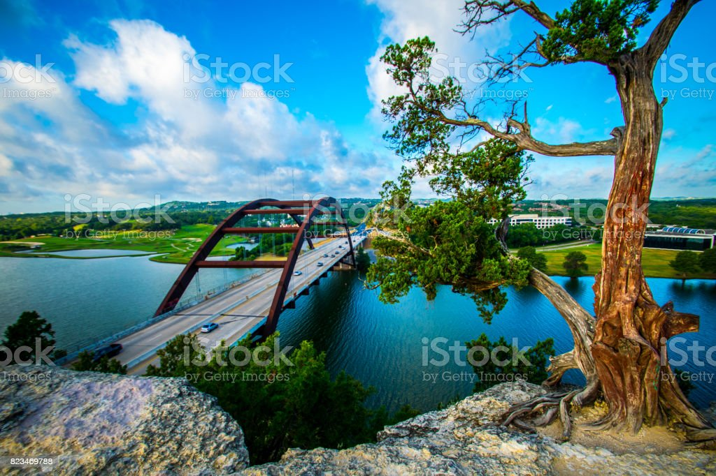 Pennybacker Bridge at Sunrise in Austin , Texas or 360 Bridge Overlook Classic Angle with Tree with Blue Town Lake stock photo