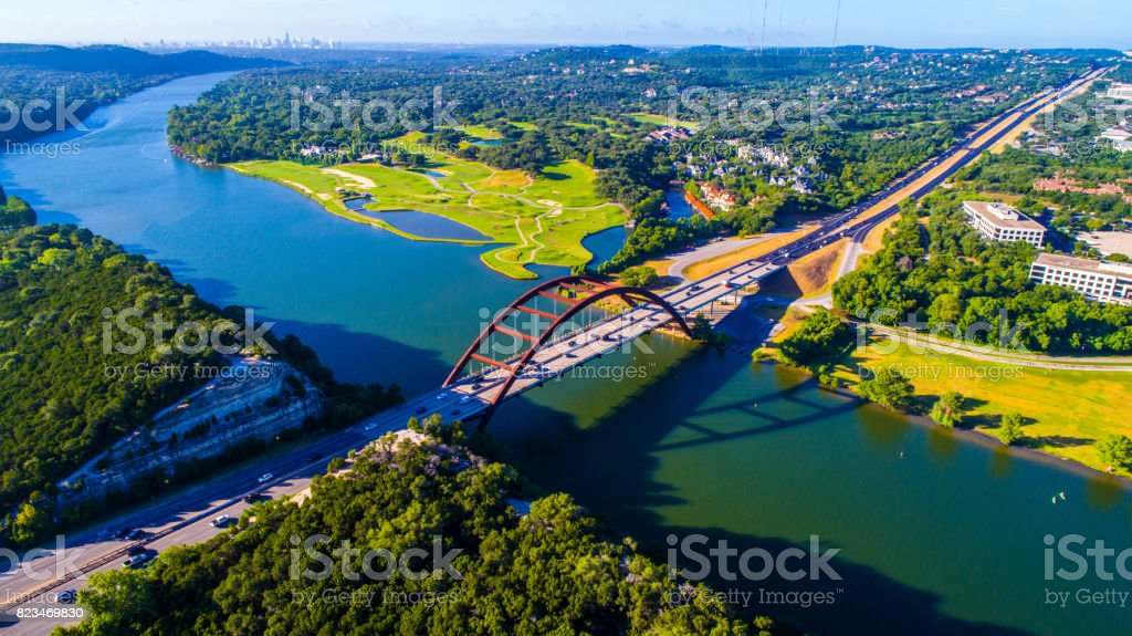 Pennybacker Bridge at Sunrise in Austin , Texas or 360 Bridge Overlook high angle from aerial drone Texas Hill Country stock photo