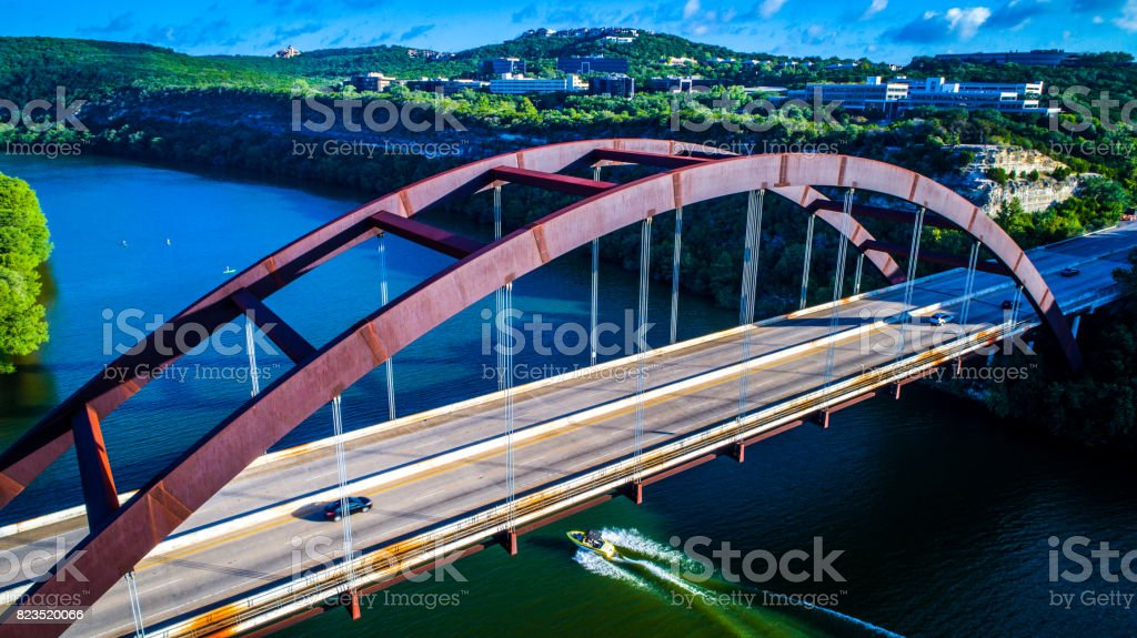 Pennybacker Bridge at Sunrise in Austin , Texas or 360 Bridge Overlook Aerial Drone View looking down on the Lake and Bridge stock photo